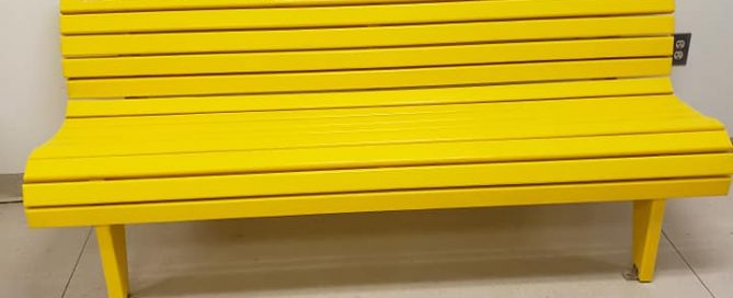 A yellow bench from Josh's Benches for Awareness.